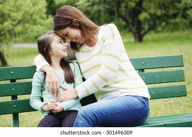 A Mother and daughter in forest on a meadow