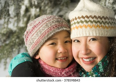 Mother and daughter in hats