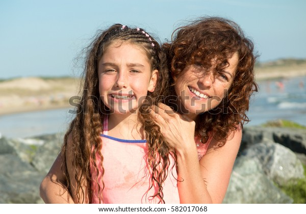 Mother and Daughter have fun on the beach on holidays