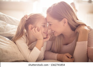 Mother and daughter have a strong connection. Mother daughter in bed.