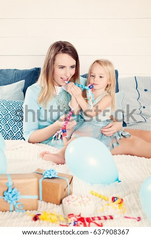 Mother And Daughter Having Fun With Birthday Gift Box Balloons Child Girl