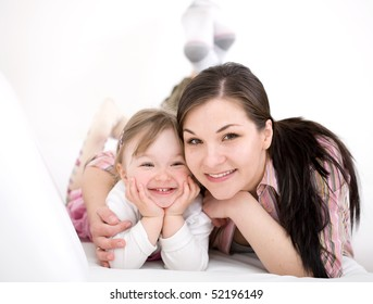 mother and daughter having fun on sofa