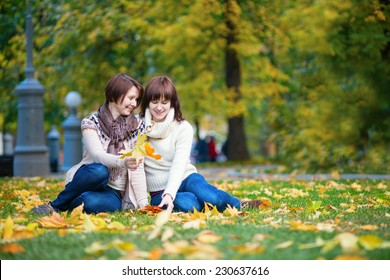 Mother and daughter having fun together on a bright fall day