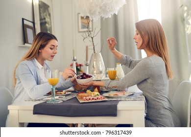 Mother and daughter having an intimate conversation over lunch offering family support and understanding conceptual of parenting