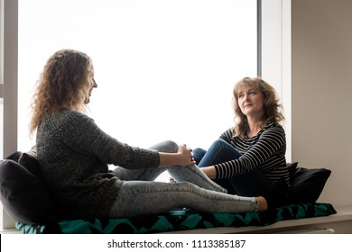 Mother and daughter having a talk at home. Good relations.