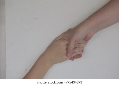 Mother and daughter hold hands tightly like their promising to take good care each other and share good moment, good feeling.