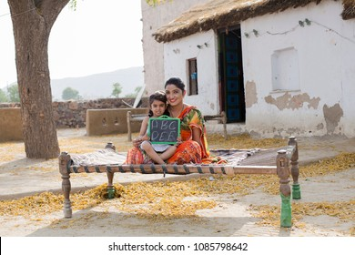 Mother with daughter holding slate