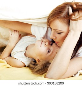 mother with daughter hugging close up, happy family inside