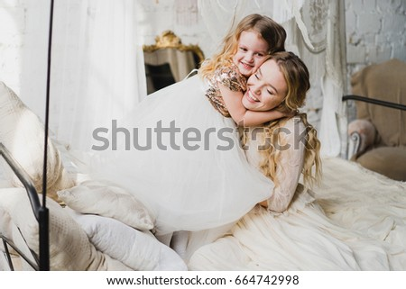 girls cuddling together