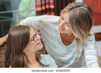 Mother and daughter hugging, smiling and sharing. Mothers day concept. Serenity and tranquility.