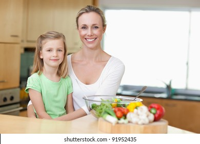 Mother and daughter in the kitchen together