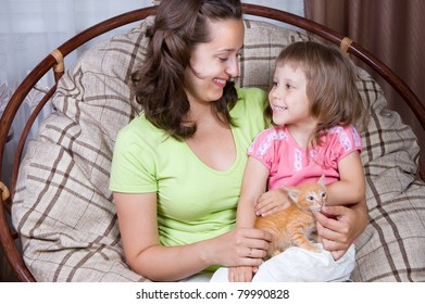 mother and daughter and the kitten,  interior