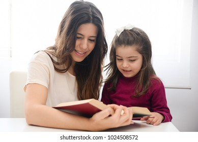 mother with daughter learn to read