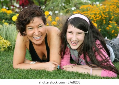 mother with daughter lies on grass