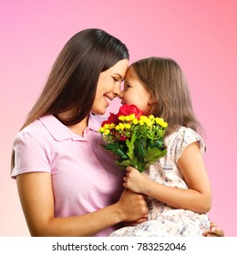 Mother and daughter look at each other - portrait on isolated  white background  Happy family people concept.