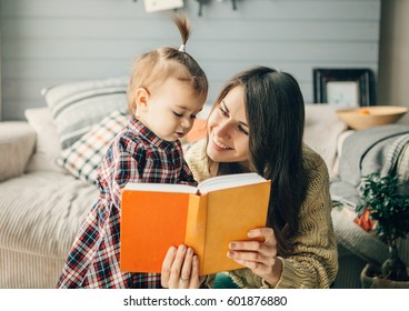 Mother and daughter looking at book together.Everyone likes read a books together.
