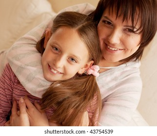 Mother and daughter looking to camera