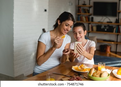 Mother and daughter looking at mobile phone