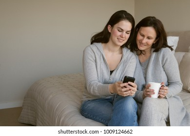 Mother and daughter looking at phone