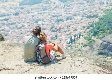 Mother and daughter looking at the town of Kalambaka bird's eye view. Meteora, Greece.