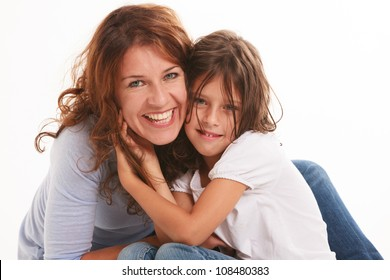 Mother and daughter in a loving pose isolated on a white background.