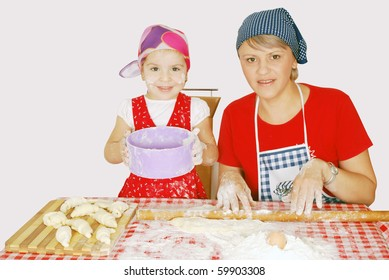 mother and daughter make rolls
