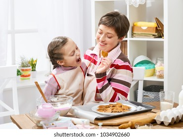 Mother and daughter making cookies and playing, healthy food concept