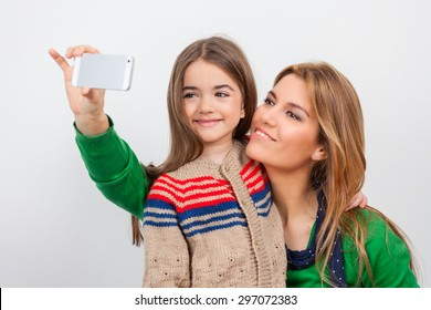 Mother and daughter making selfie at home for Christmas.