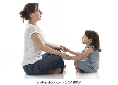 mother and daughter making yoga on white background
