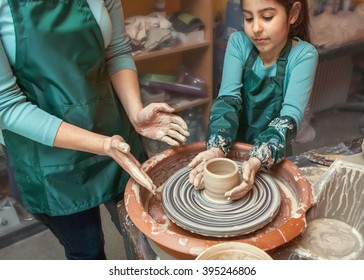 mother and daughter mold with clay, pottery children