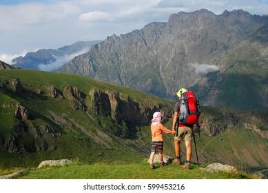 Mother and daughter. Mountain hike near Kazbek. 10 september 2012. Caucasus mountains. Georgia. Europe
