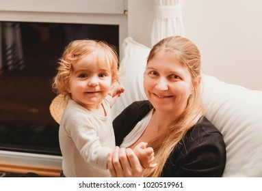 Mother with daughter on armchair - Essen, Germany