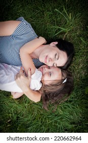 Mother and daughter on the grass