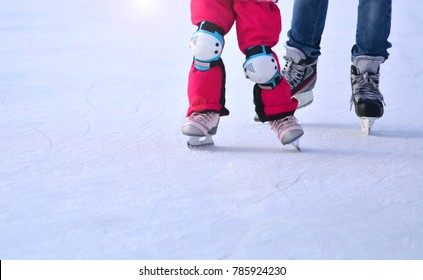 Mother and daughter on ice skaiting rink