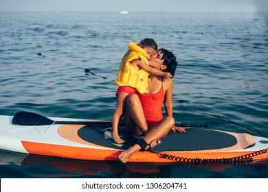 Mother with daughter on a paddle board