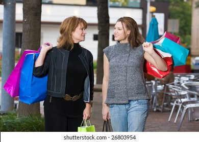 Mother and daughter on a shopping trip together in the city.