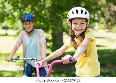 Mother and daughter on their bike on a sunny day