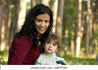 Mother and daughter outside in the park