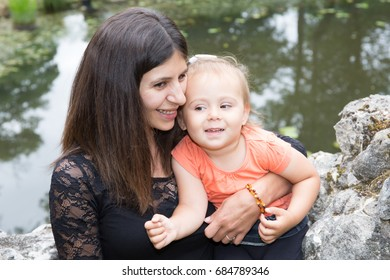 Mother and daughter in park. Mother Day