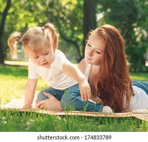 Mother and daughter in the park.   Mother day concept