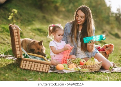 mother and daughter at a picnic with a German shepherd dog