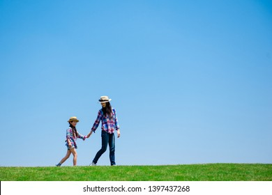 Mother and daughter playing in the meadow