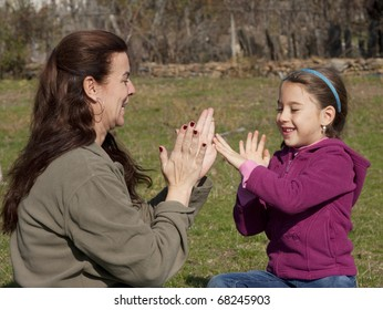 Mother and daughter playing outdoor