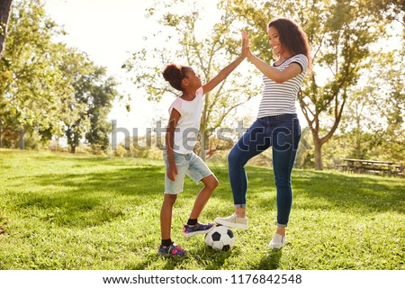 1290282b Mother Daughter Playing Soccer Park Together Stock Photo (Edit Now ...
