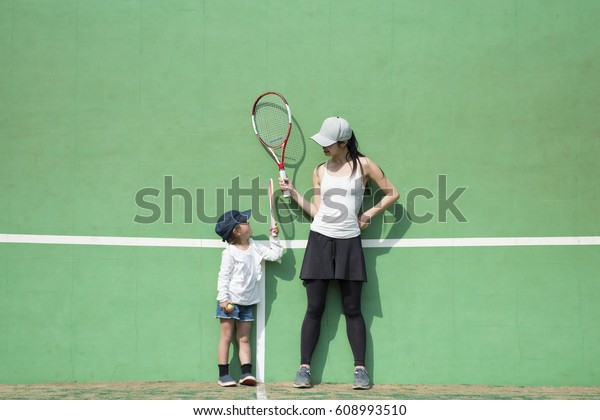 Mother and daughter playing tennis