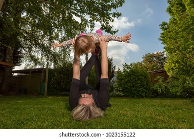mother and daughter playing together in the backyard