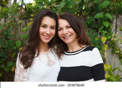 Mother and daughter portrait in a outdoor setting.