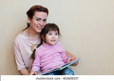 mother with the daughter read the book, education and family values and love