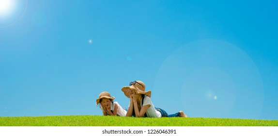 Mother and daughter relaxing in the meadow