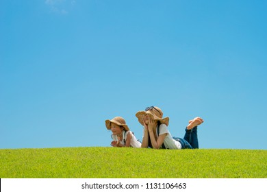 Mother and daughter relaxing on the lawn